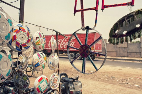 Coca Cola truck as seen through decorated wheel caps, Sirhind