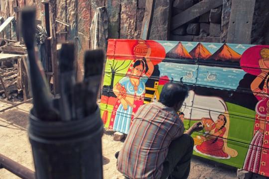Raja painter finishing a panihari painting