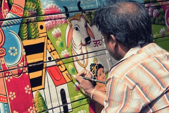 Raja painter signing his name